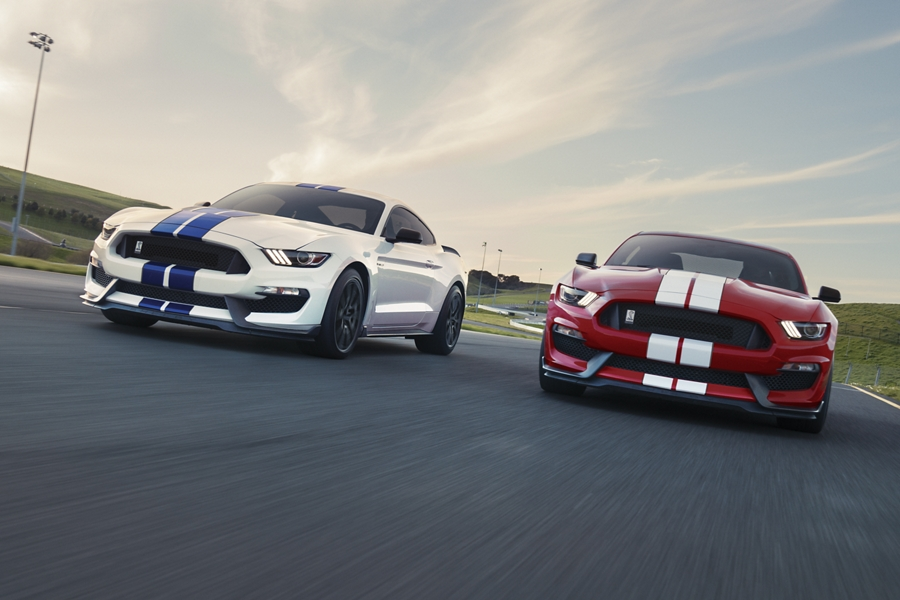 Two 2020 Ford Mustang G T 3 50 vehicles driving alongside one another on racetrack