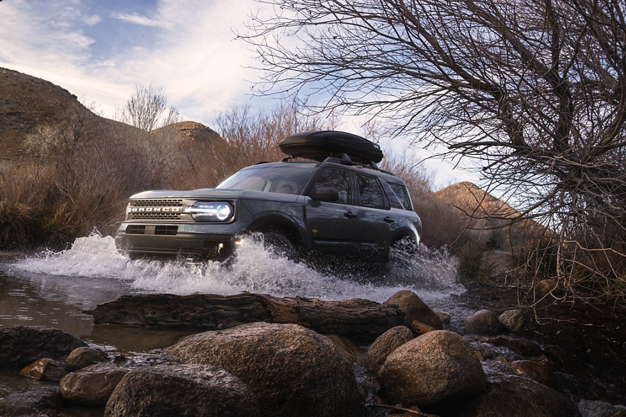A 2021 Ford Bronco Sport being driven through water off road