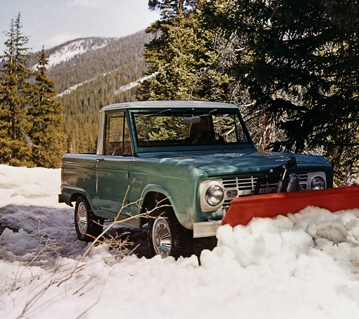 1967 Ford Bronco Pickup in Holly Green with a Wimbledon White roof and snowplow attachment used to plow snow