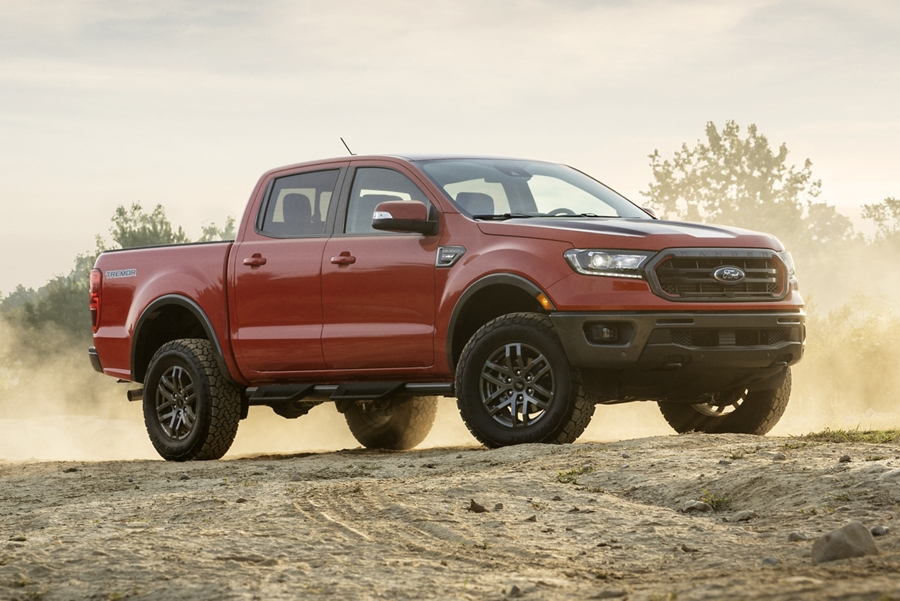 2021 Ford Ranger LARIAT in Race Red with Tremor Off Road Package being driven on dirt road