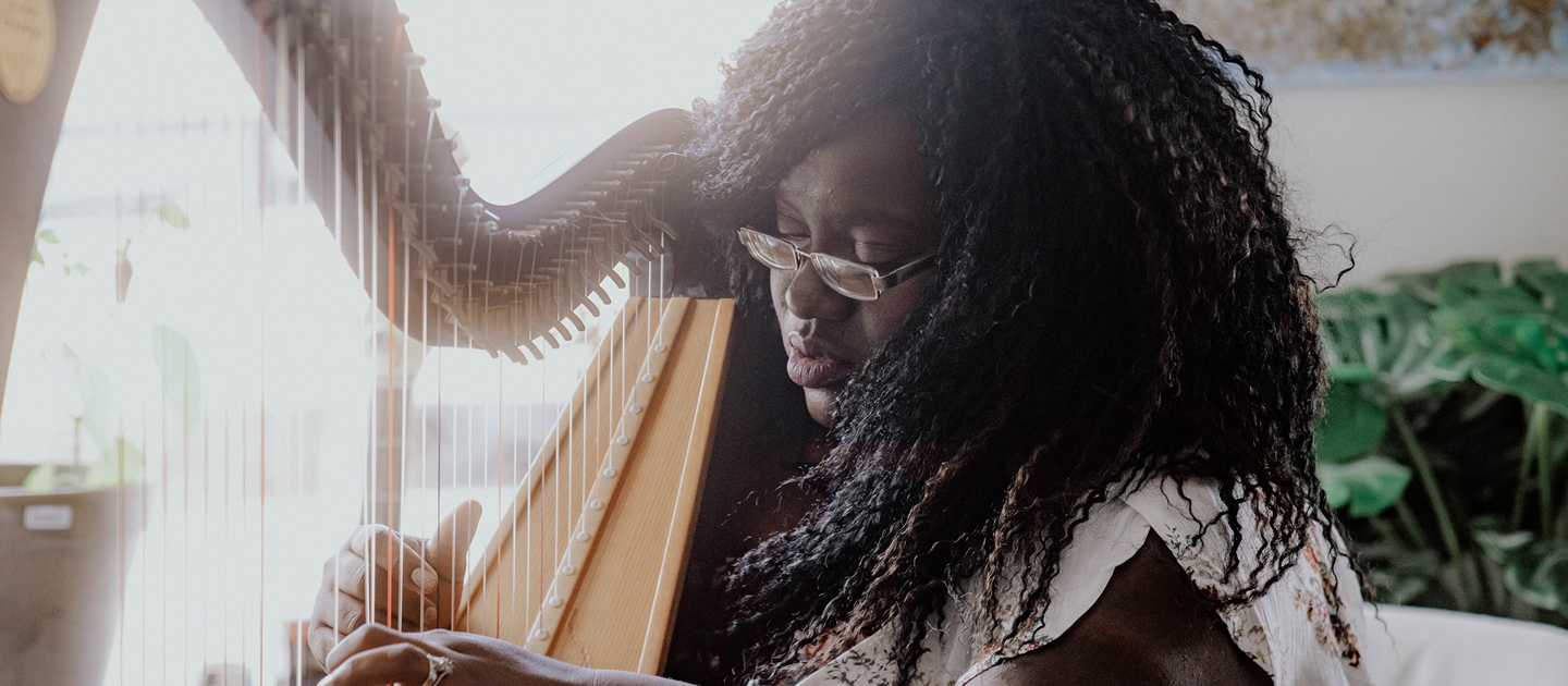 Edem showing off how she can play multiple instruments.