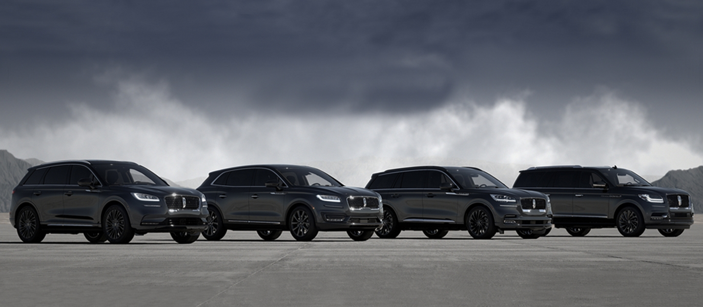 Four Lincoln vehicles are shown parked next to each other in the Infinite Black Monochromatic exterior color package?