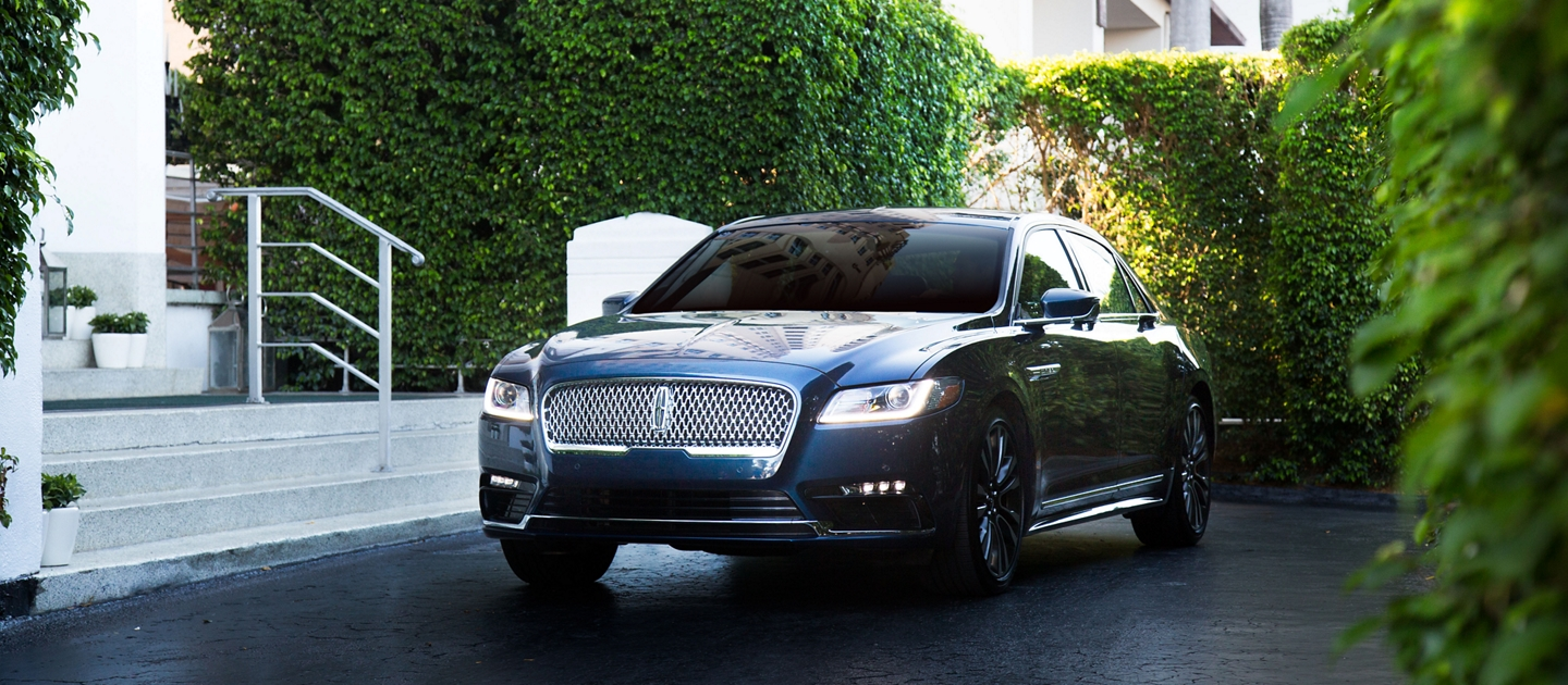 Lincoln Continental shown here in front of hotel