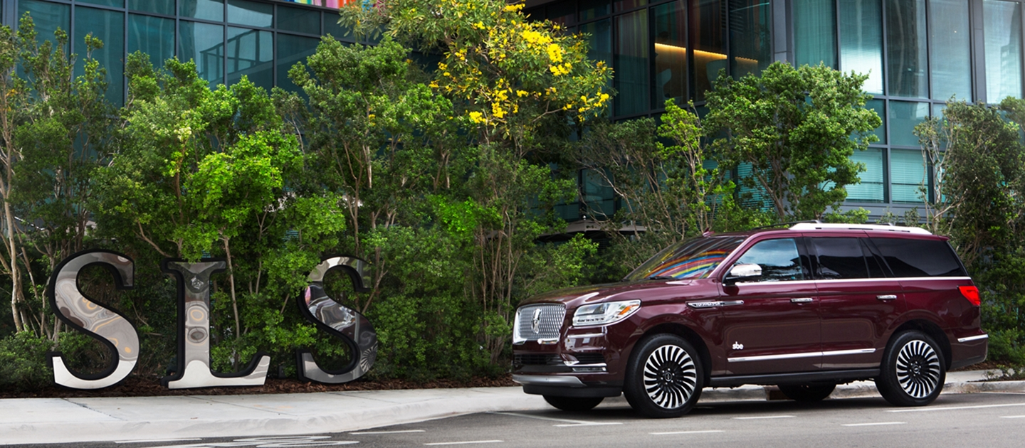 Lincoln Navigator shown here in front of hotel
