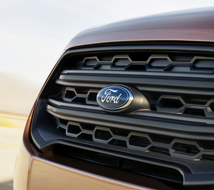 The 2019 Ford EcoSport S E S black painted bars and surround with black headlight bezels