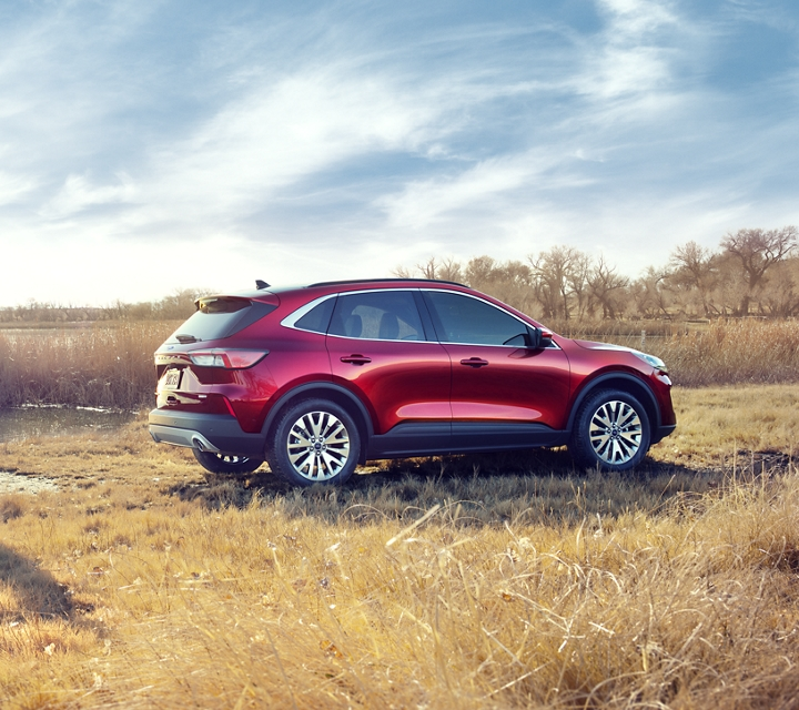 2020 Ford Escape Titanium gas in Rapid Red with a young group boating by a lake