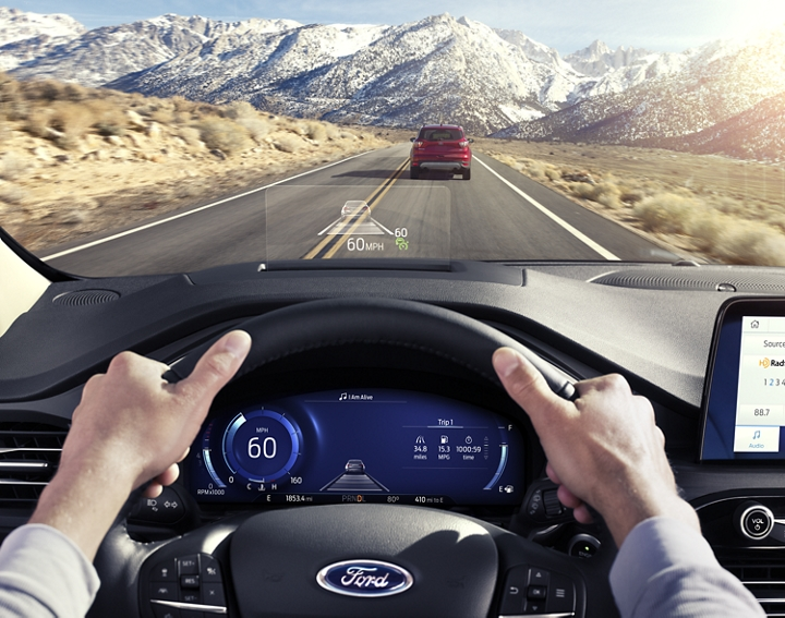 Driver point of view looking out on the road with the available head up display