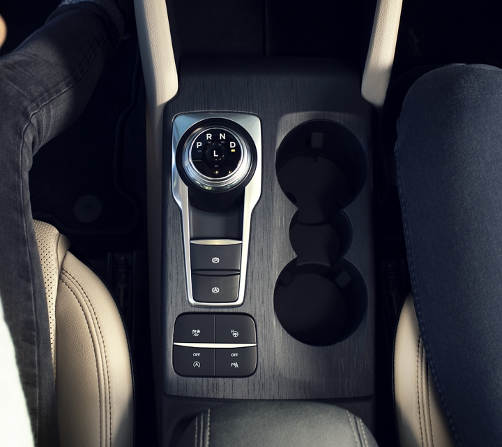Interior of new rotary gear shift dial and cupholders