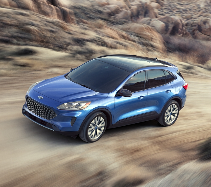 2020 Ford Escape driving on a mountain road