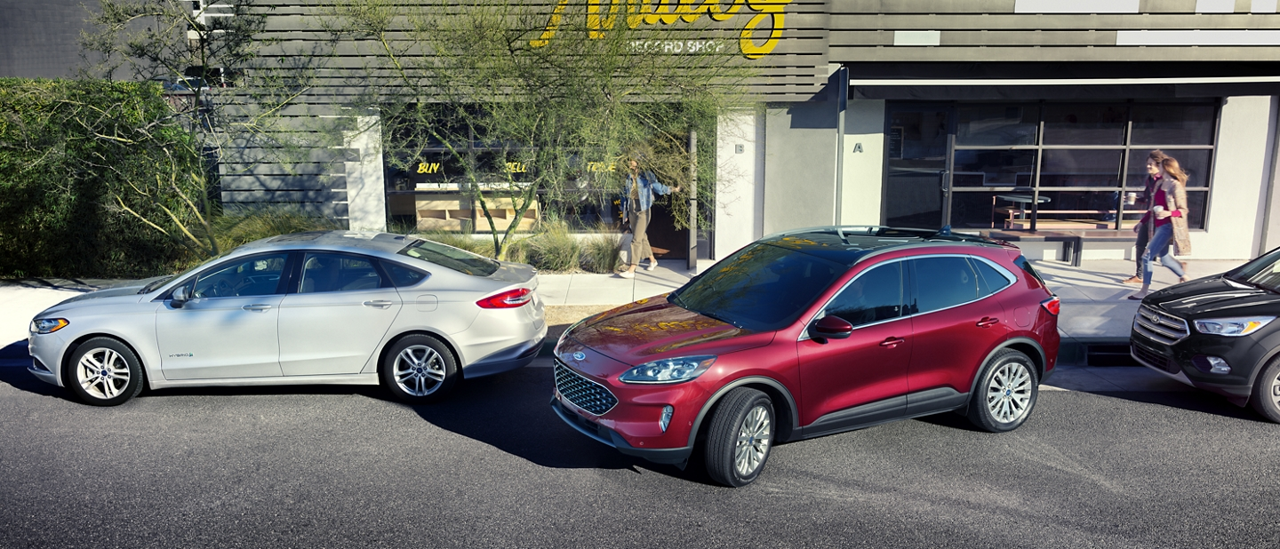 2020 Ford Escape in Rapid Red backing into a parking space