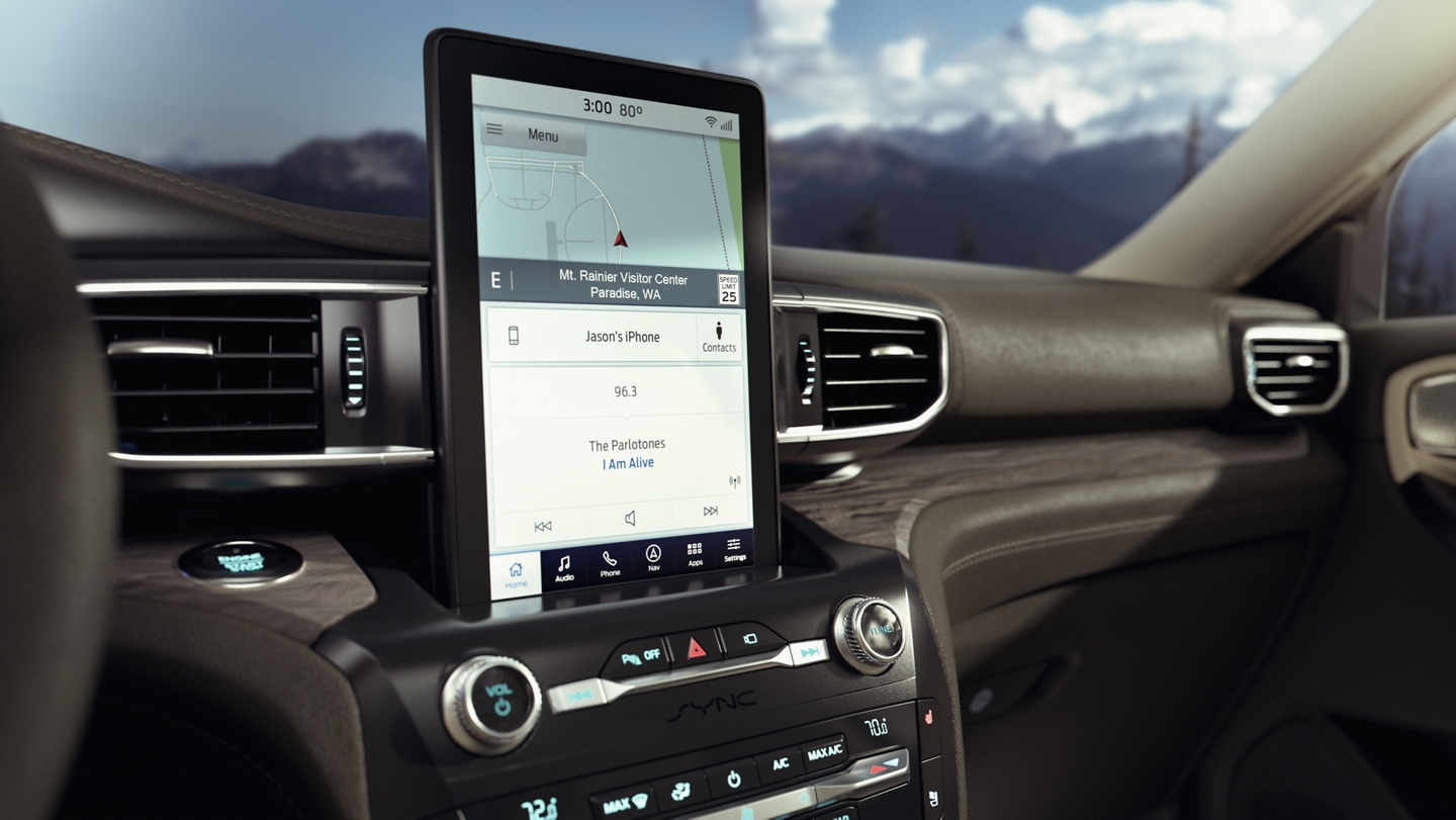A close up view of an Explorer dashboard featuring a portrait touchscreen in the centre stack and SYNC 3