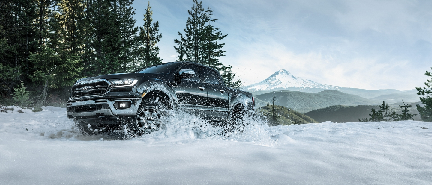 The 2019 Ranger driving through a snow covered trail