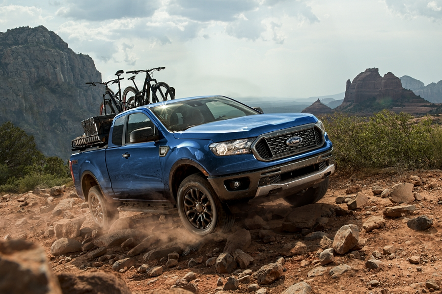 2019 Ford Ranger traveling off road with trail bikes on pickup bed rack