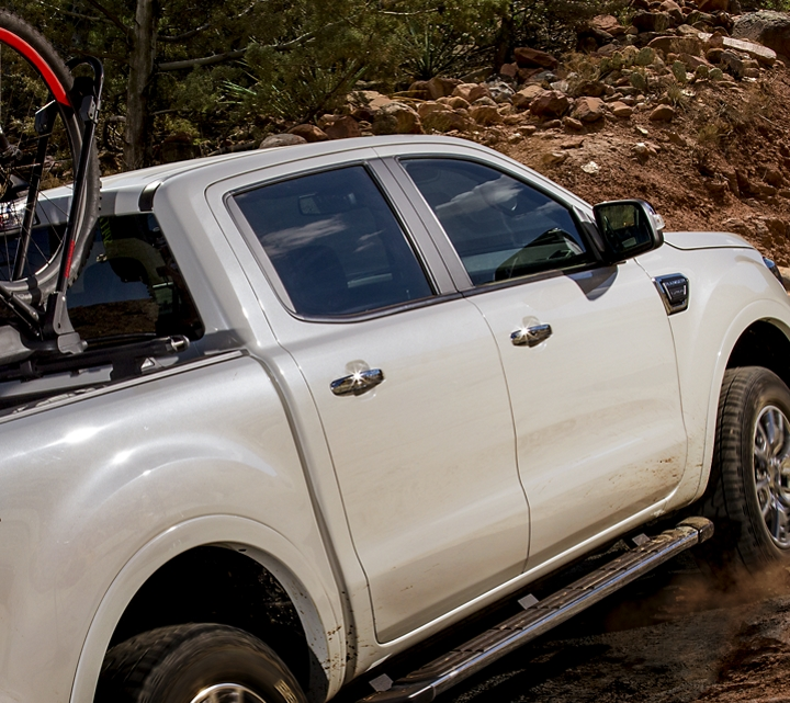 2019 Ford Ranger driving up a dirt and rock covered path