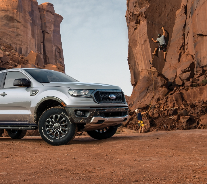 2019 Ford Ranger parked next to a bluff with rock climbers in background