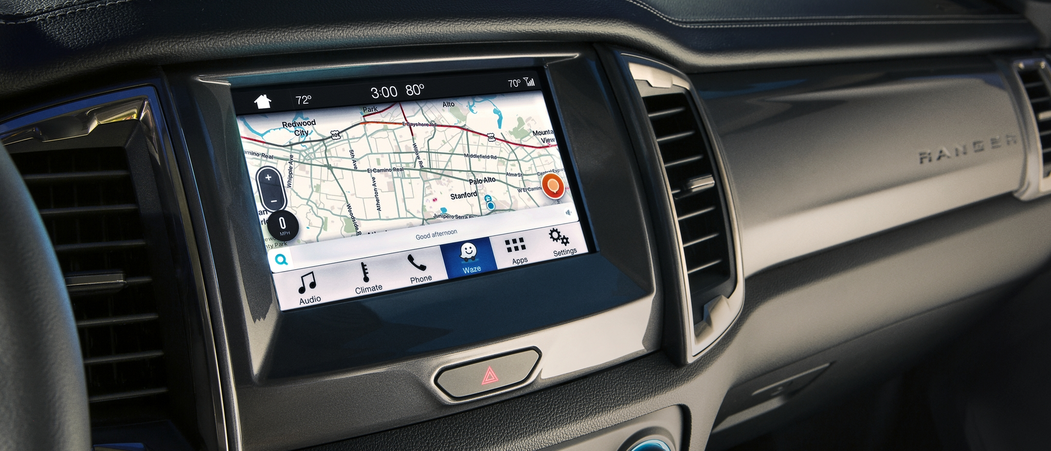 An image of the center console with the WAZE app up and fully functional on the SYNC 3 screen