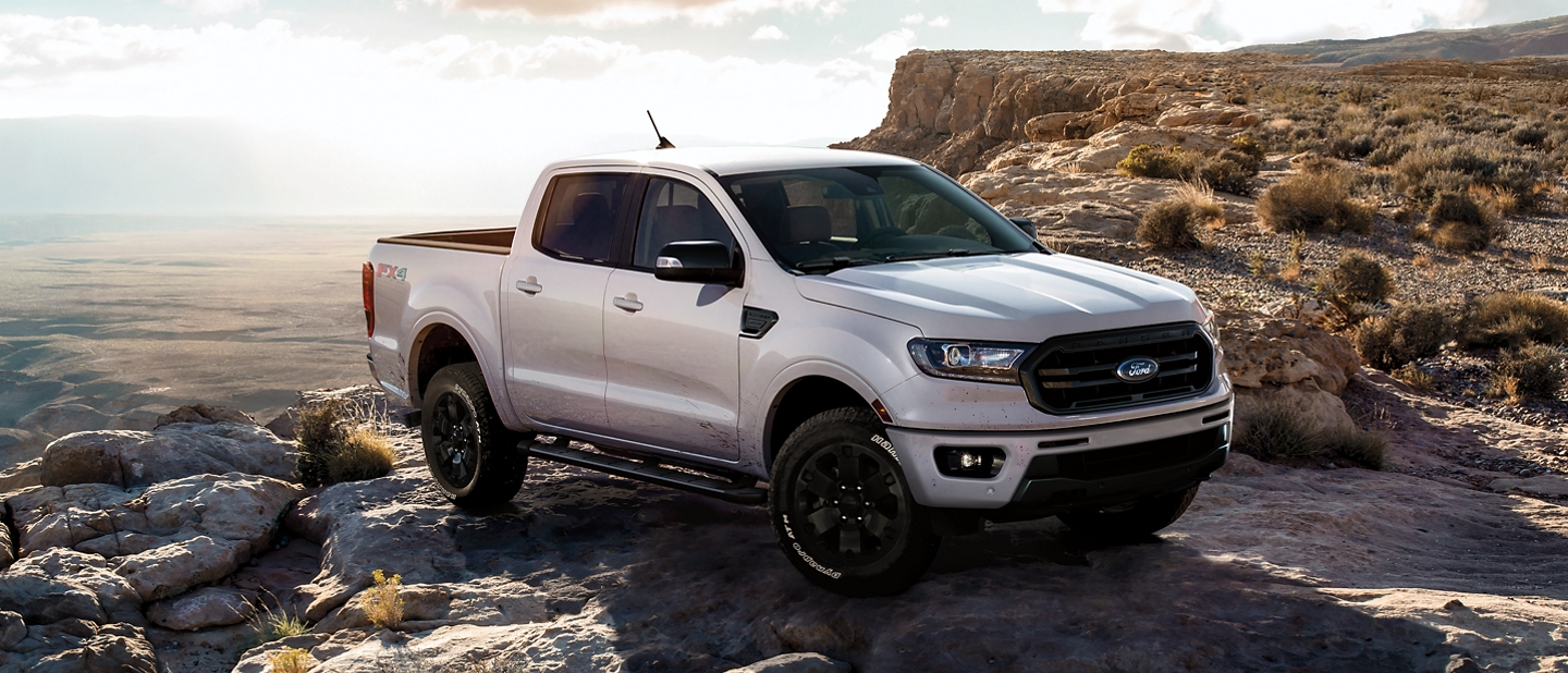 By the edge of a cliff is an all new 2019 Ford Ranger LARIAT Super Crew in White Platinum Tri Coat Metallic and Black Appearance Package
