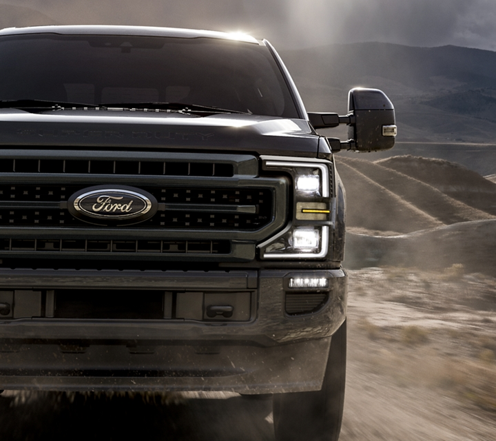 A 2020 Super Duty on a dirt road in the mountains