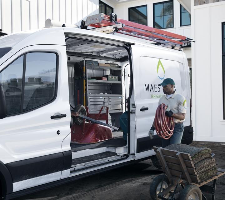 Transit cargo van on a worksite with side cargo door open