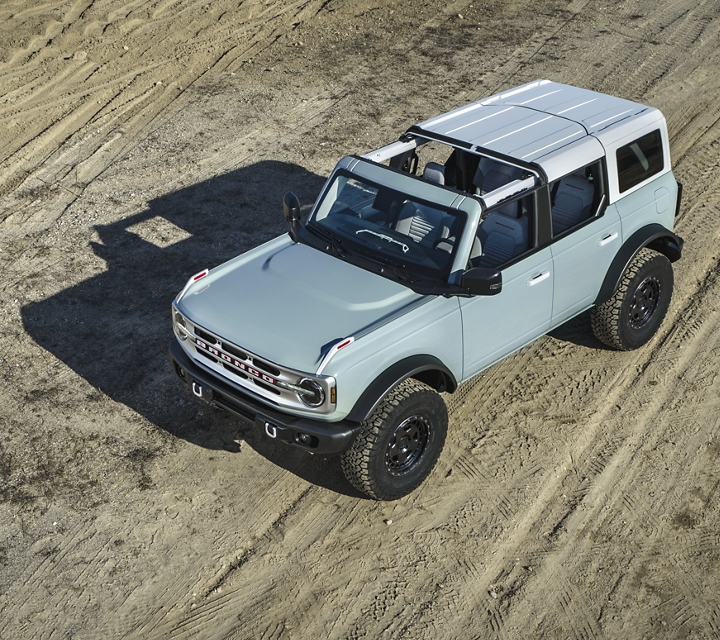 2021 Ford Bronco in cactus gray from an overhead view parked on sand