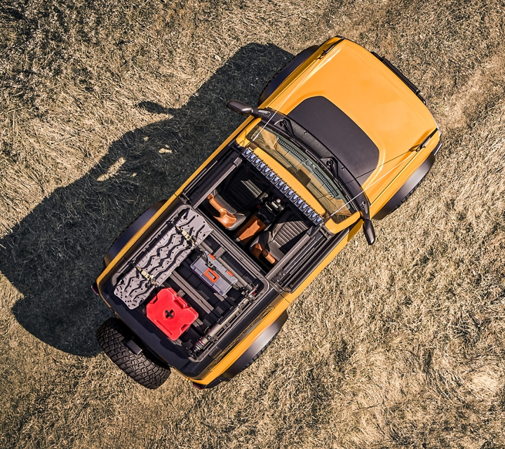 View from above looking down on a 2021 Ford Bronco Design Property shown off road in Cyber Orange Metallic