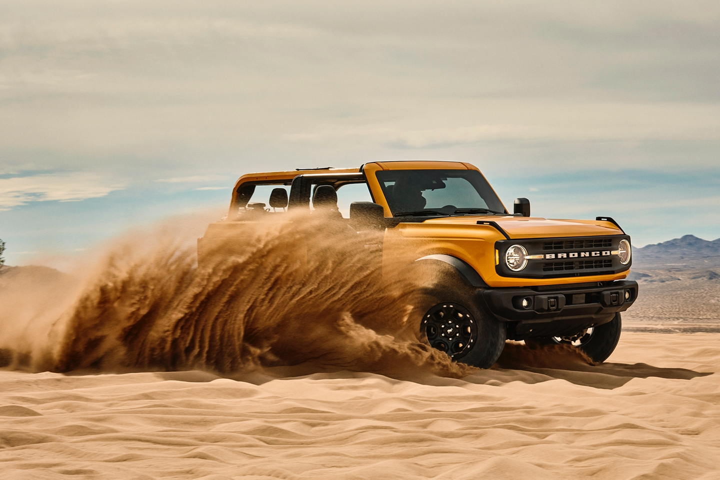 2021 Ford Bronco being driven through the sand dunes
