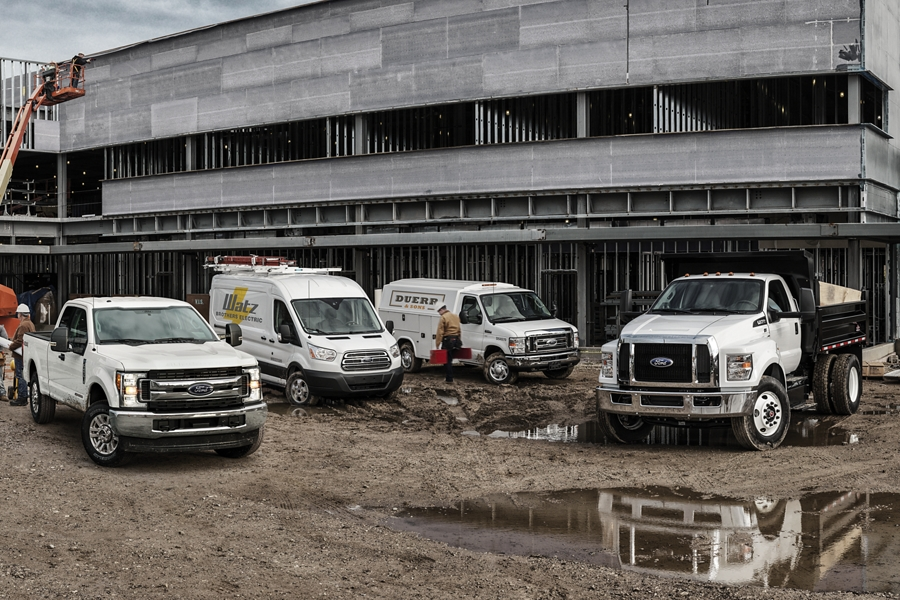 2020 Ford Super Duty Transit Cargo Van E Series Cutaway and Medium Duty truck with aftermarket equipment at construction site