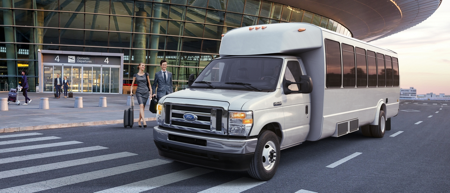 2021 Ford E Series Cutaway with aftermarket shuttle bus at airport