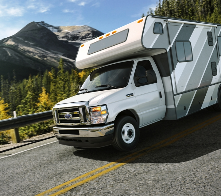 2021 Ford E Series dual rear wheel cutaway with Class C motor home being driven on the open road