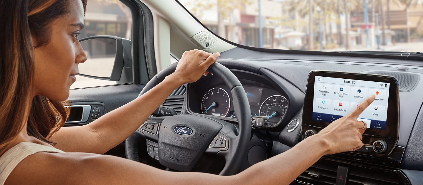 2020 Ford EcoSport interior with Ebony black seating and bold copper accents featuring an available 8 inch touchscreen