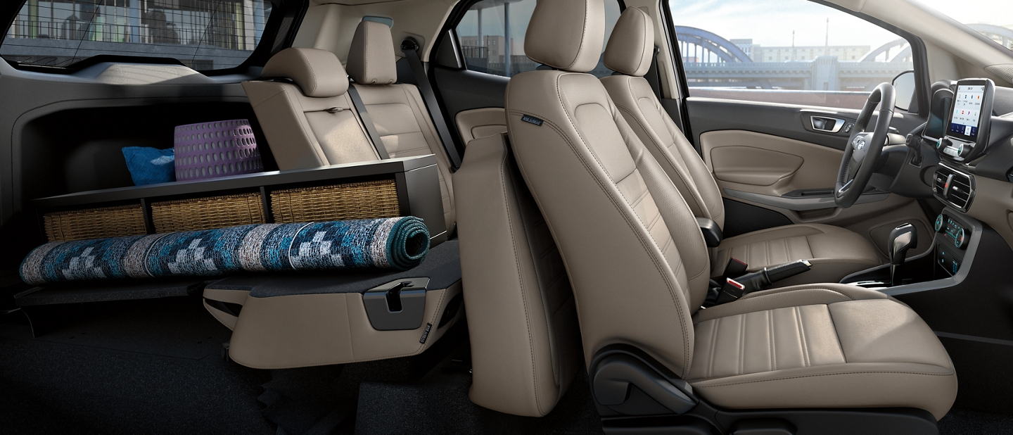 2020 Ford EcoSport rear cargo area with one seat folded down and home supplies packed inside