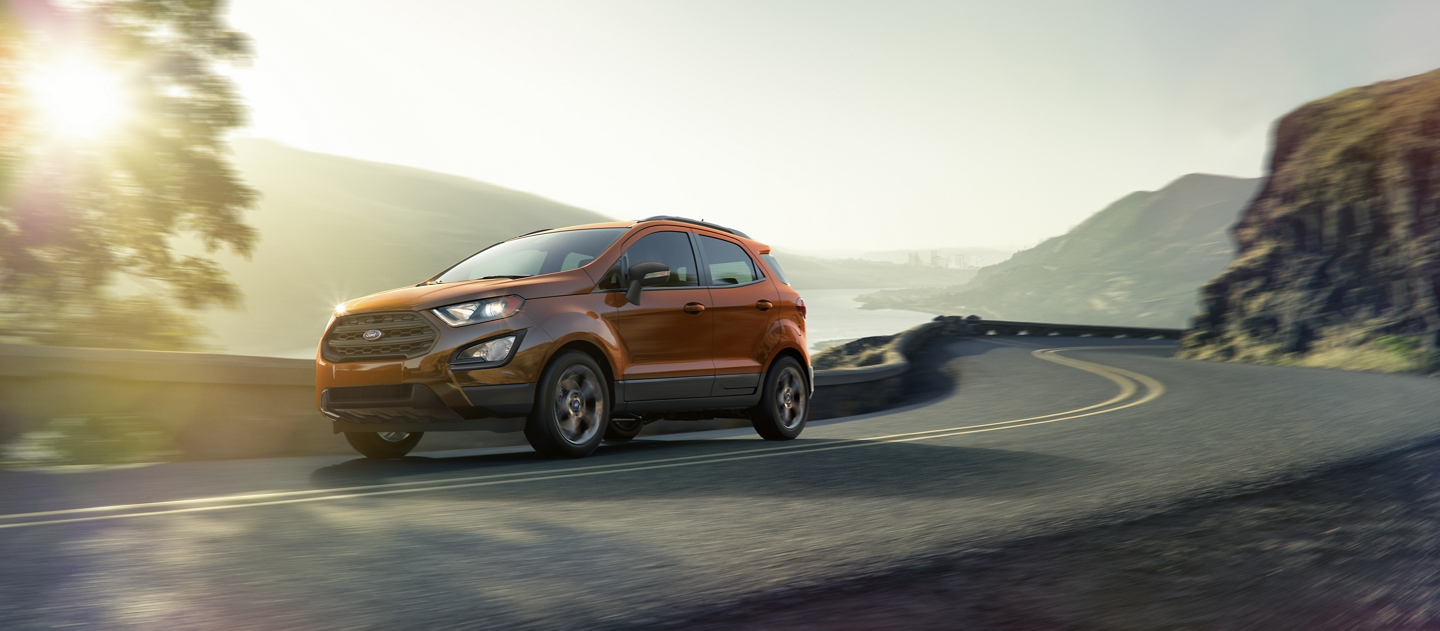 A 2020 Ford EcoSport in Canyon Ridge being driven in the mountains