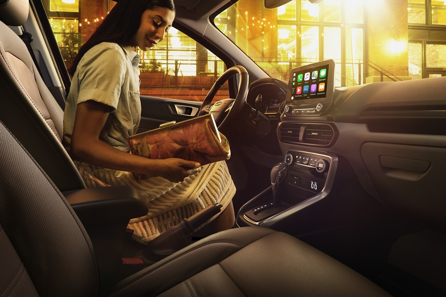 2020 Ford EcoSport interior with a woman in the drivers seat