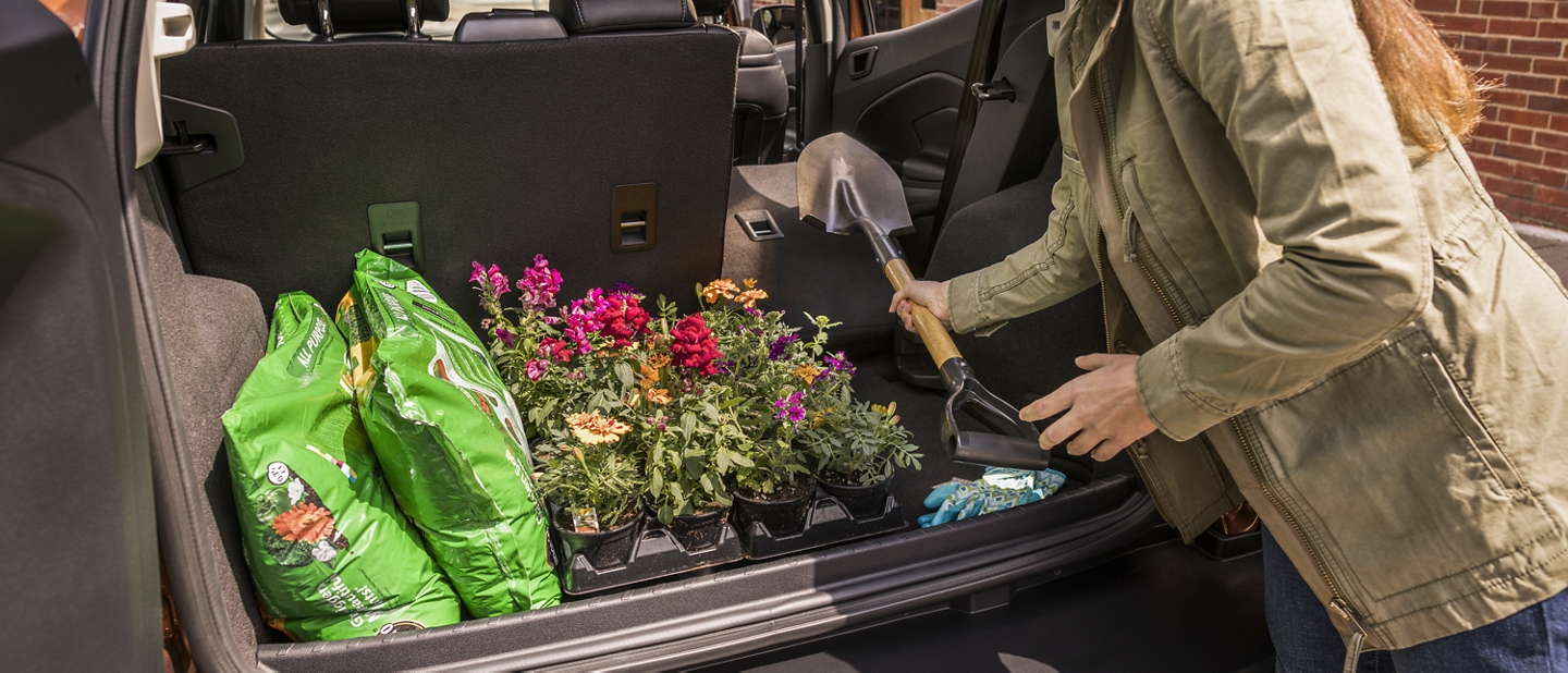 2020 Ford EcoSport rear cargo area with one seat folded down and gardening supplies packed inside