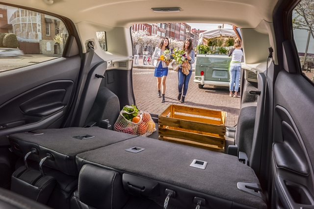 2020 Ford EcoSport rear cargo area with seats folded down and cargo packed inside