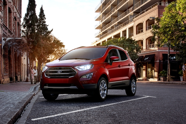 A 2020 Ford EcoSport in ruby red parked in front of a restaurant