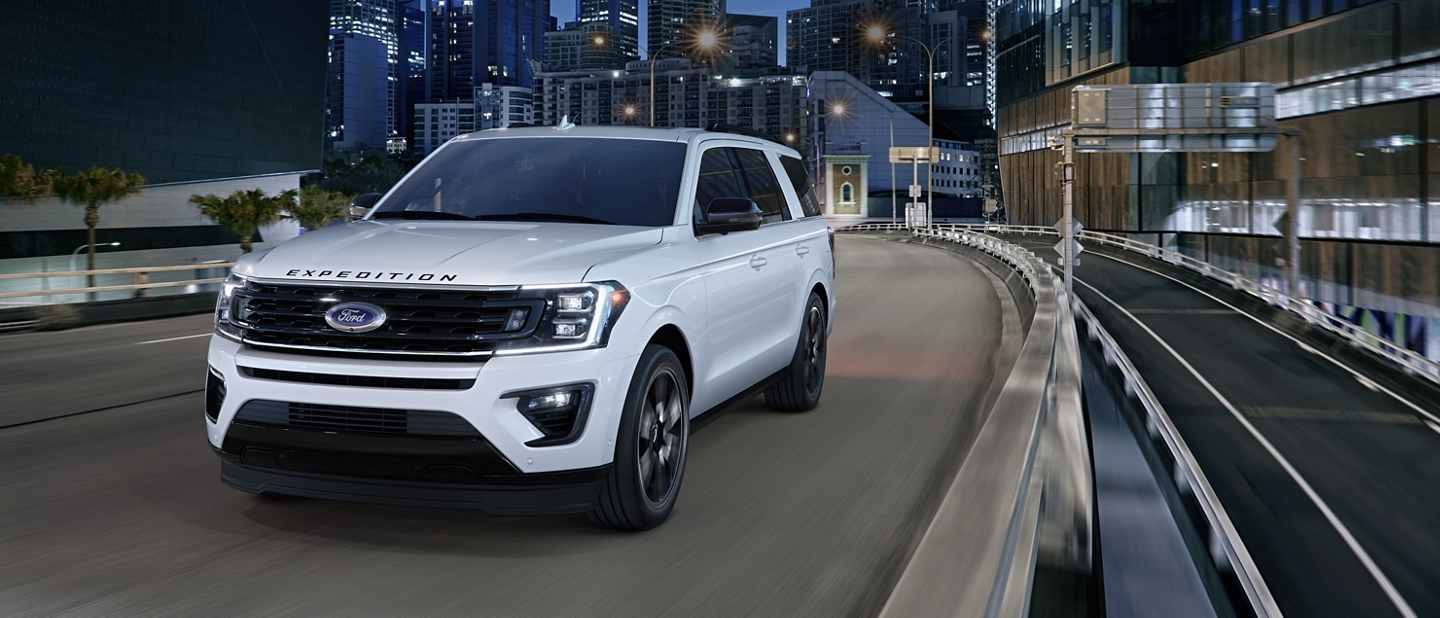 Head turning 2020 Ford Expedition Stealth Edition on the road at night