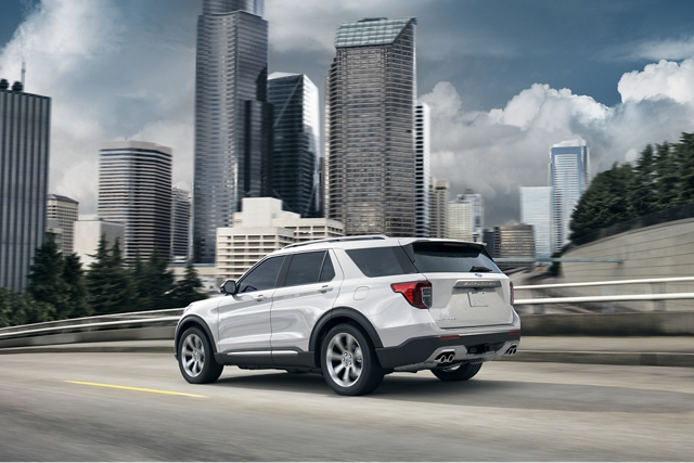 A 2020 Explorer in Star White driving down the highway