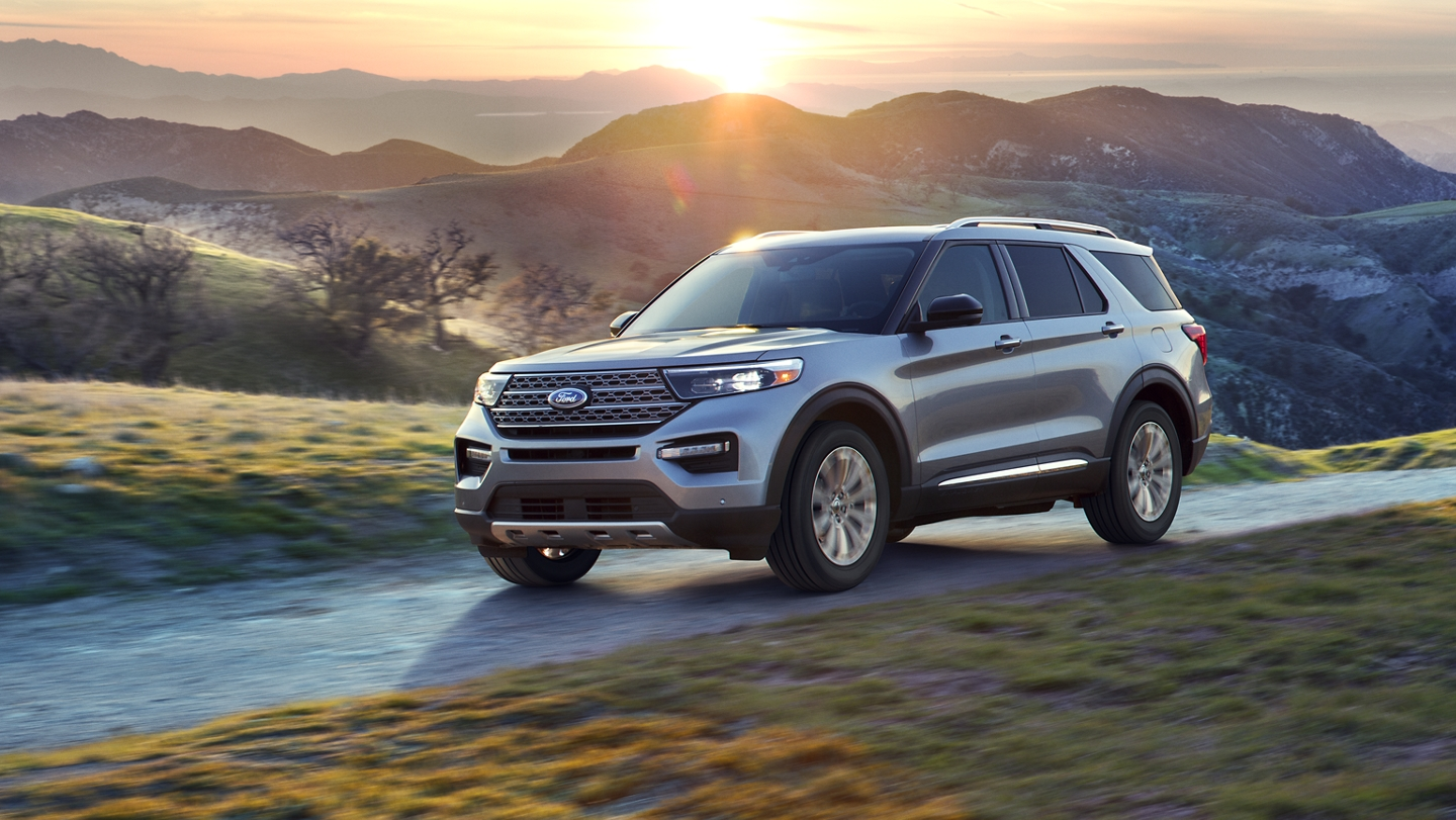A 2020 Explorer in Iconic Silver with a beautiful mountain background