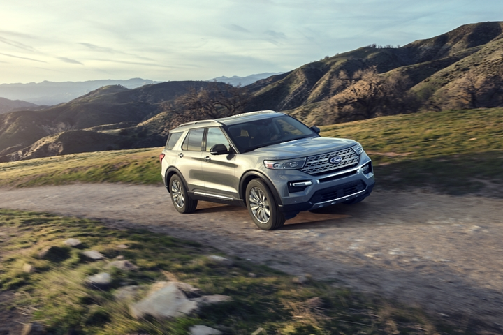 A 2020 Explorer Limited in Iconic Silver being driven up a steep hill