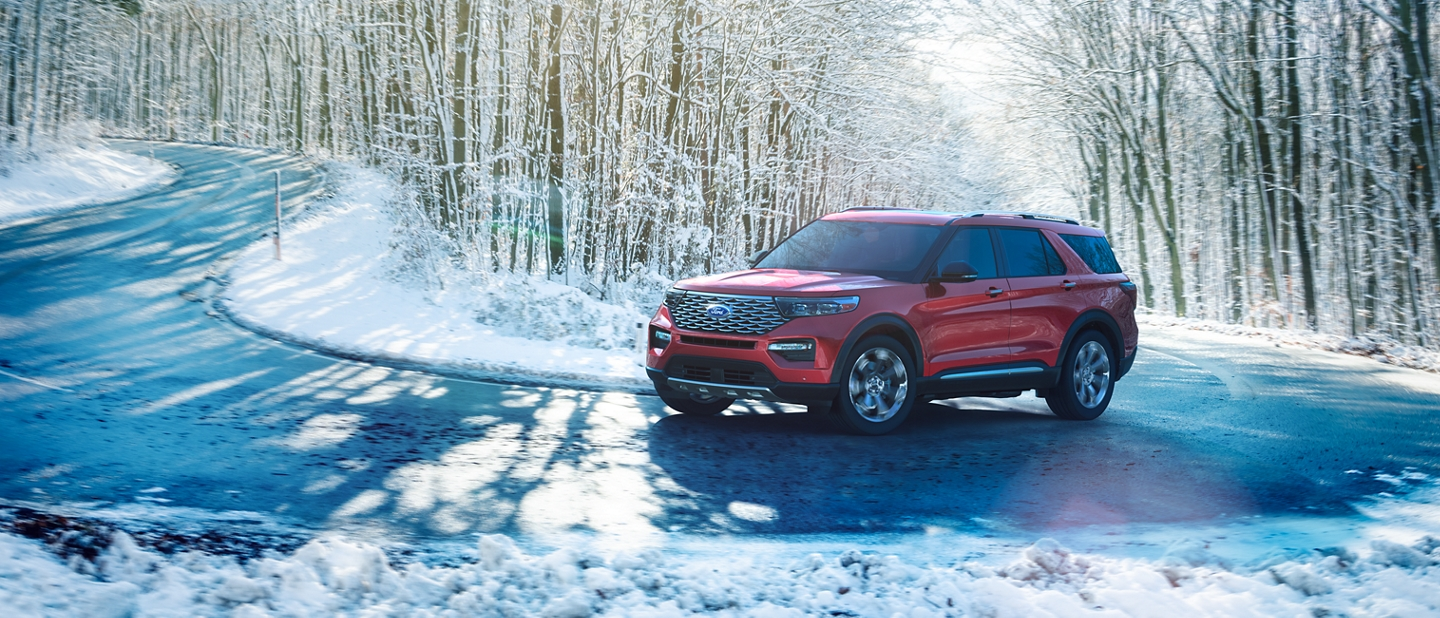 A 2020 Ford Explorer being driven through a snow covered forest