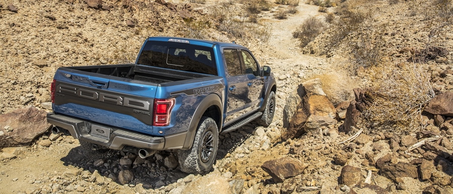 2020 Ford F 1 50 Raptor traveling on steep off road decline