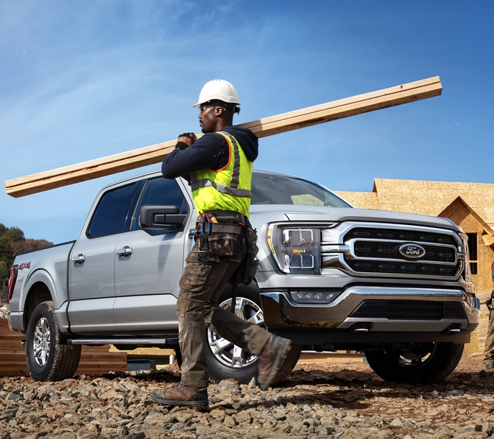 A construction worker working near a 2021 Ford F one fifty