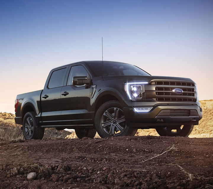 A 2021 Ford F one fifty lariat sport parked on a hill