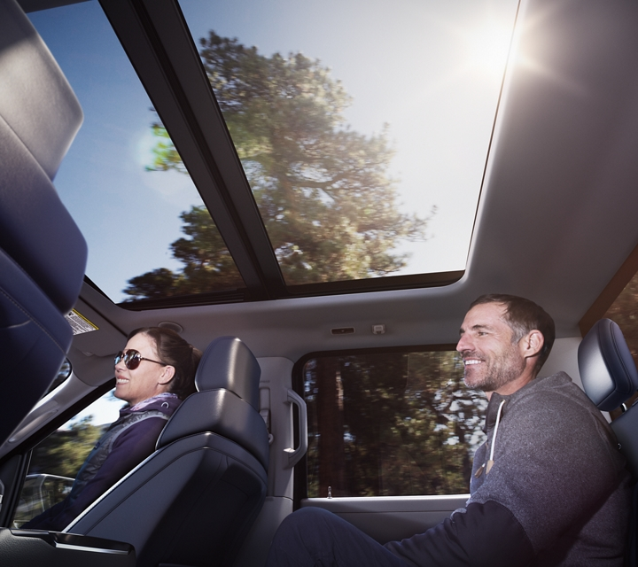 A view from the rear seat of a 2021 Ford f one fifty where a man sits talking to a woman in the front passenger seat