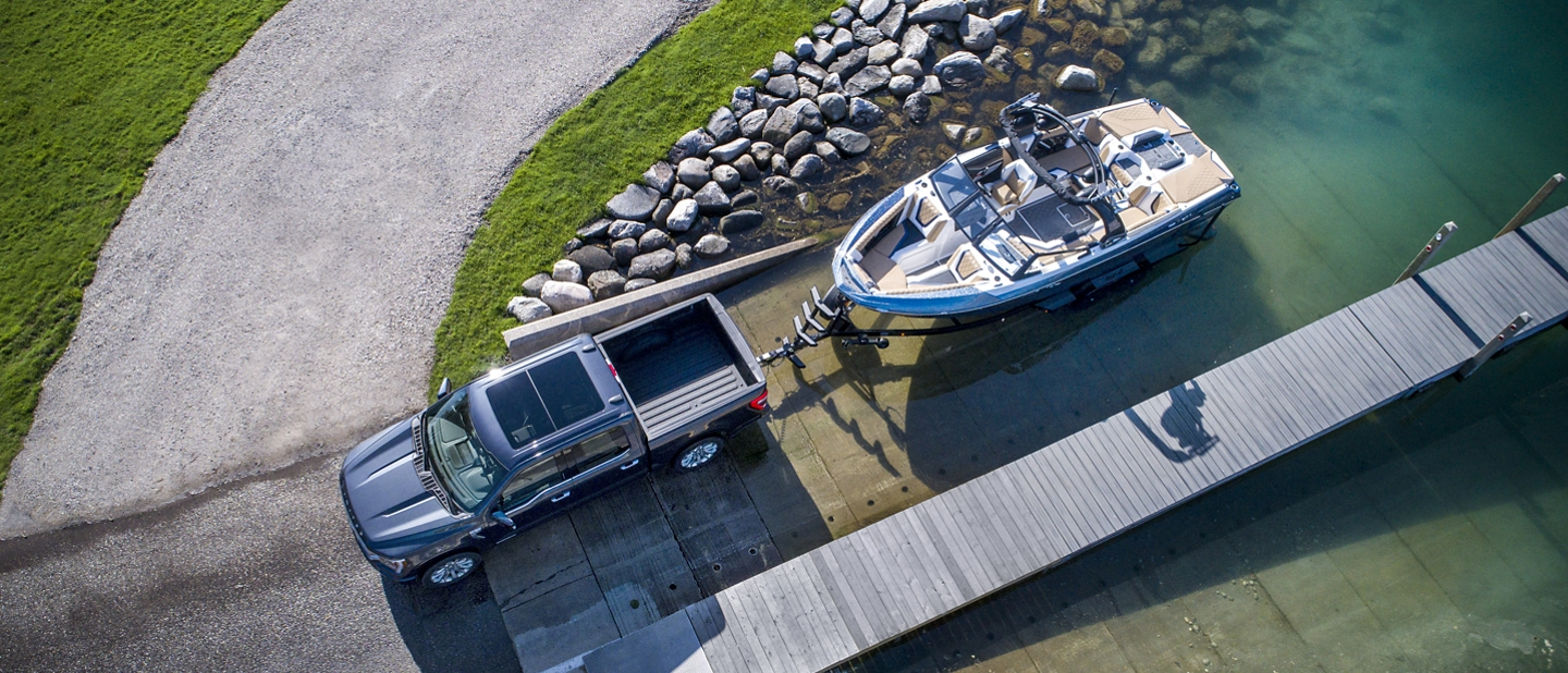 A 2021 Ford F one fifty towing a boat over a bridge