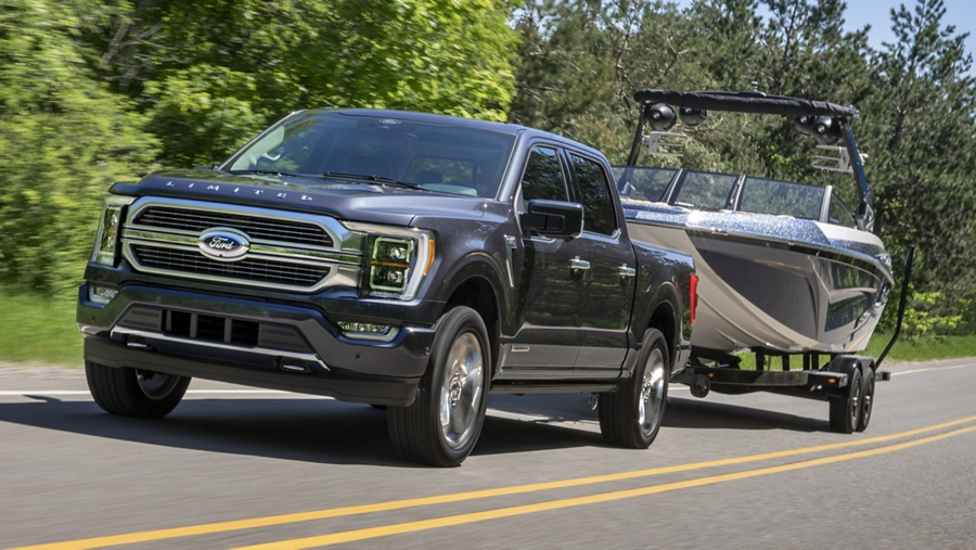A 2021 Ford F one fifty towing a boat