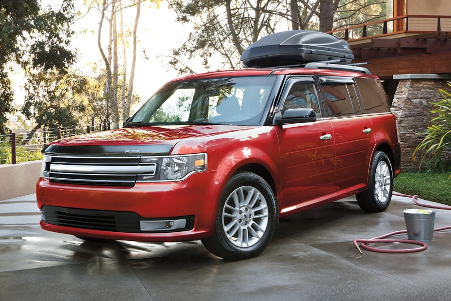 A 2019 Ford Flex parked on a wet driveway after a car wash