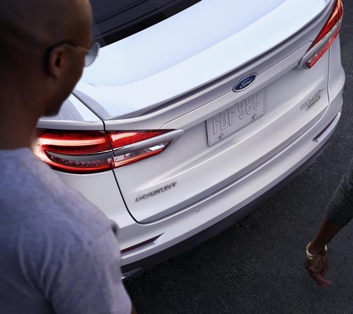 2020 Ford Fusion Titanium shown in White Platinum Metallic with rear spoiler