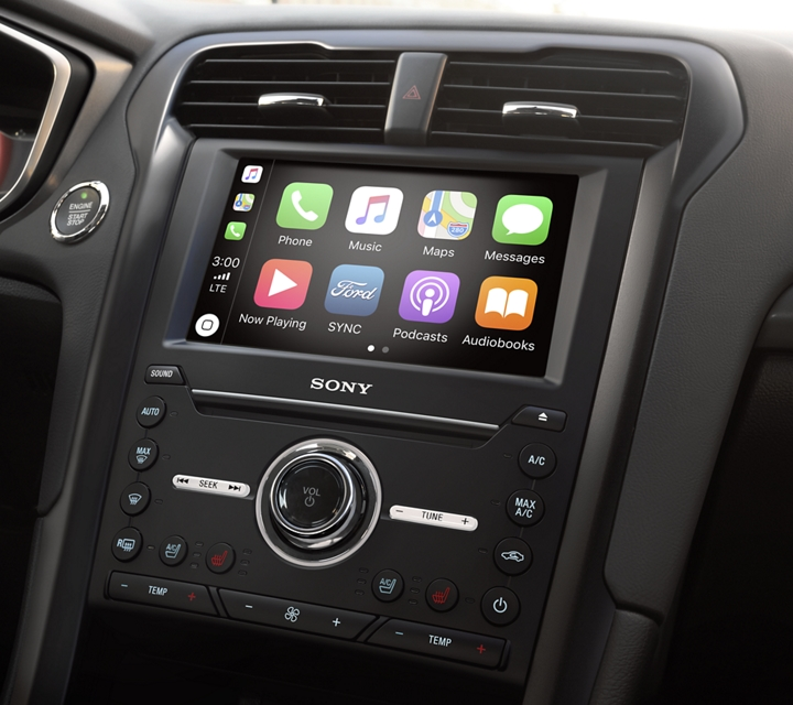A closeup of the 2020 Ford Fusion center touchscreen with Sync 3 voice activated technology featuring apple carplay and android auto
